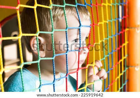 sad, thoughtful little boy, looking into the distance - stock photo