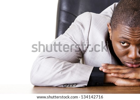 Sad, tired or depressed businessman at the desk. - stock photo