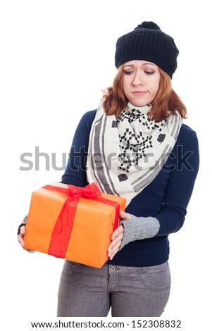 Sad winter woman looking at present, isolated on white background. - stock photo