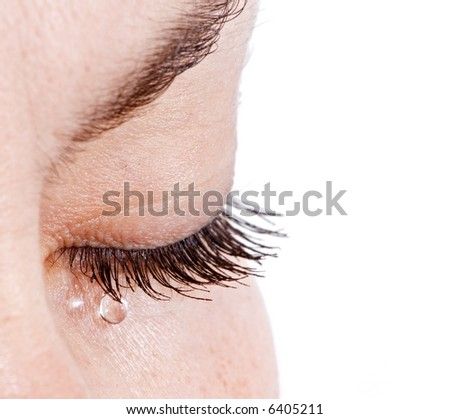 Sad woman concept - closed eyelid closeup with a teardrop on eyelashes - isolated - stock photo