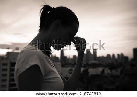 Sad woman in the city - stock photo