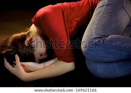 Sad woman laying after being abused