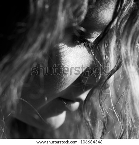 Sad woman looking down - stock photo