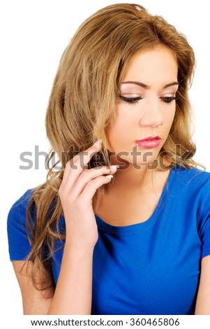 Sad woman looking down. - stock photo
