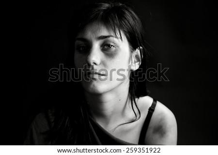 Sad woman looking in camera - stock photo