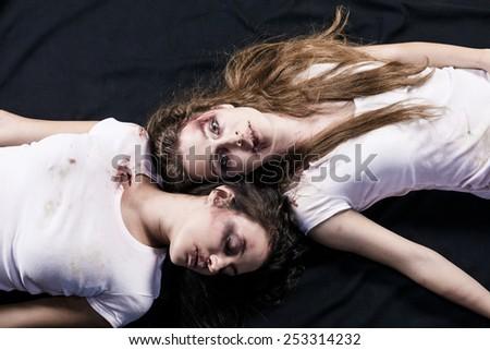 Sad woman lying on the floor - stock photo