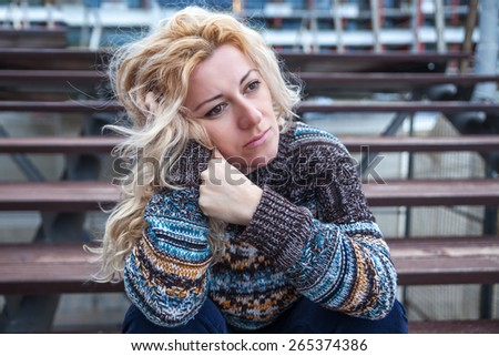 Sad woman on a street - stock photo