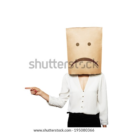 sad woman pointing at something. isolated on white background - stock photo