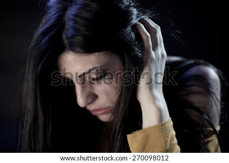 Sad woman scared of being hit by husband - stock photo