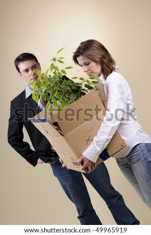 sad woman taking her stuff and manager in background - stock photo
