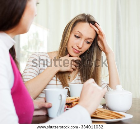 Sad woman  telling to friend about her problems