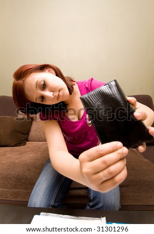 Sad woman with empty wallet - stock photo