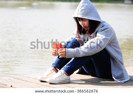 Sad Woman with Red Paper Heart - stock photo