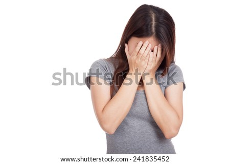 Sad young Asian woman crying with face on palm  isolated on white background - stock photo
