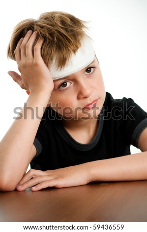 Sad Young Boy with Bandage on his Head - stock photo