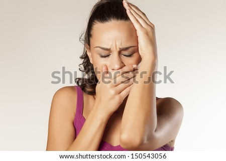 sad young girl has a toothache and headache - stock photo