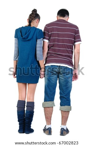 Sad young pair. Rear view. Isolated over white. - stock photo