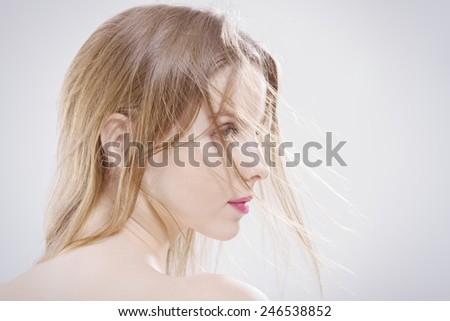 sad young woman profile - stock photo