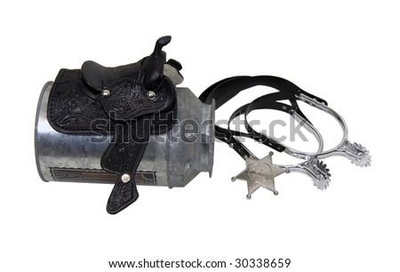 Saddle made of heavy black leather for riding domestic horses on a milk tin with spurs and sheriff star - path included - stock photo
