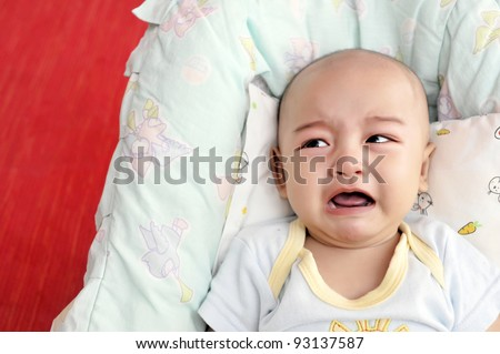 Sadly baby boy crying loudly calling his mother. - stock photo
