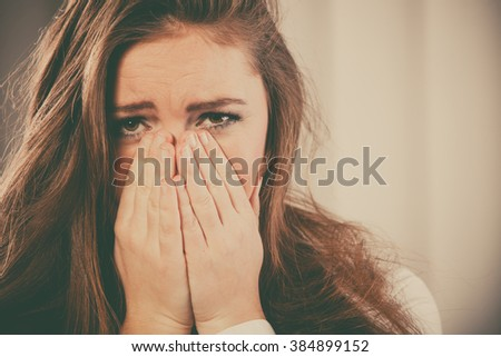 Sadness and emotional distress. Stressful situation in work trouble and anxiety. Young woman in white shirt cry.  - stock photo