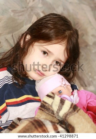 Sadness girl with her doll, child depression - stock photo