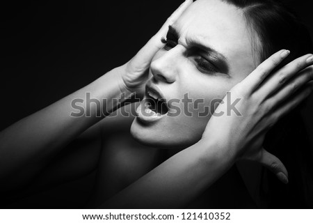 Sadness.  Woman screaming - Headache. Depression, Stress