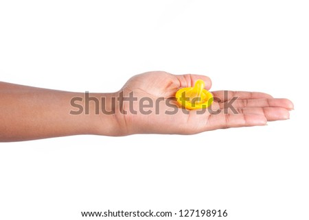 Safe sex concept. African woman Hand with condom, isolated on white background - stock photo