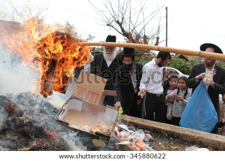 SAFED, ISRAEL - April 3, 2015 : Jews burn leavened bread in ritual on morning prior to Passover  ( Pesach ).