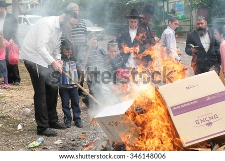 SAFED, ISRAEL - April 3, 2015 : Jews burn leavened bread in ritual on morning prior to Passover. ( Pesach )