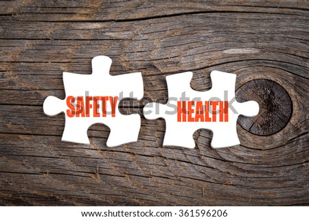 Safety and Health - words on puzzle.Conceptual image. - stock photo