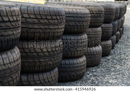 Safety Barrier Fence racing old tire - stock photo