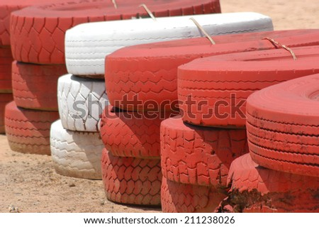 Safety barriers made of old wheels in oudoor carting and racetraks                                - stock photo