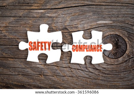 Safety Compliance - words on puzzle.Conceptual image. - stock photo