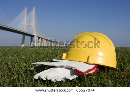 Safety concept on construction places - Yellow helmet and gloves - stock photo