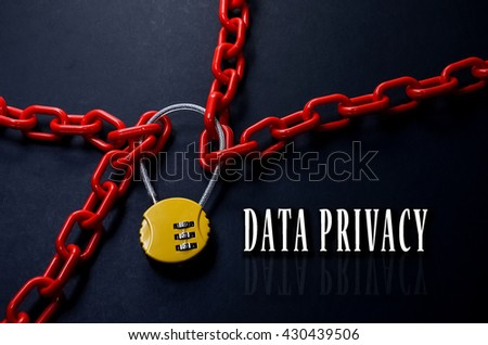 Safety Concept. Red chain and yellow padlock with number combination on blackboard with word Data Privacy. - stock photo