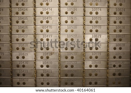 Safety deposit boxes in a bank vault. - stock photo