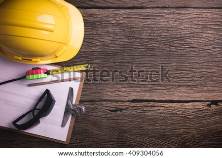 Safety equipment on wooden background with copy space. Retro style Color