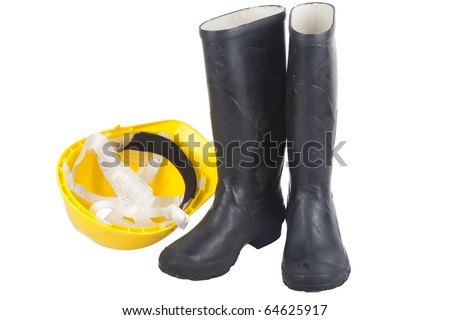 Safety equipment - PPE equipmnet of hardhat and steel toe boots - stock photo