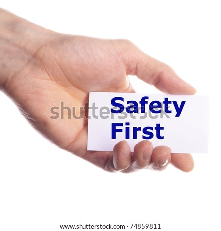 safety first concept with hand word and paper - stock photo