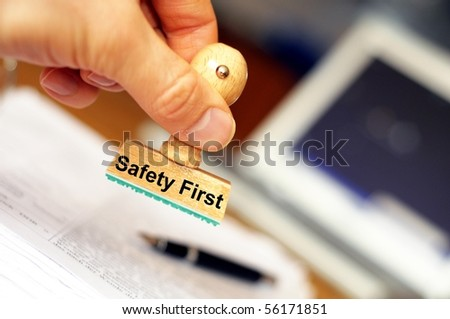 safety first concept with stamp in insurance office - stock photo