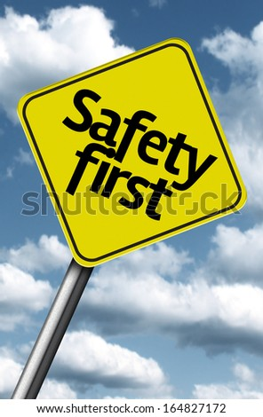 Safety First creative sign on a beautiful blue sky - stock photo