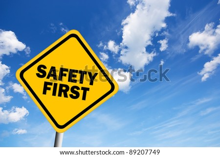 Safety first illustrated sign over blue sky - stock photo