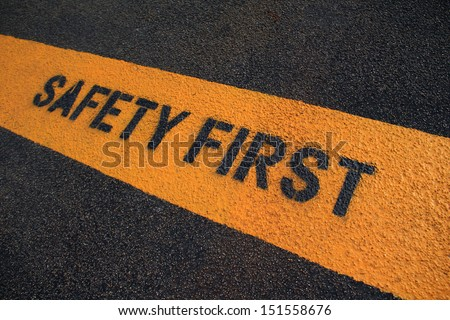 Safety First sign on caution strip.  - stock photo