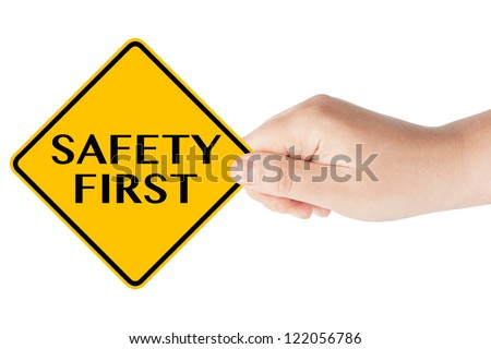 Safety First traffic sign with hand on the white background - stock photo