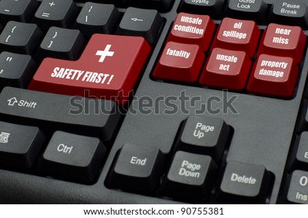 safety first word with type of incidents on red and black keyboard button - stock photo