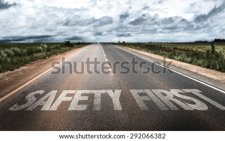 Safety First written on rural road - stock photo