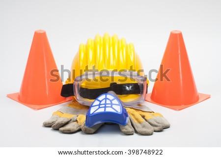 Safety gear kit close up on grey background - stock photo