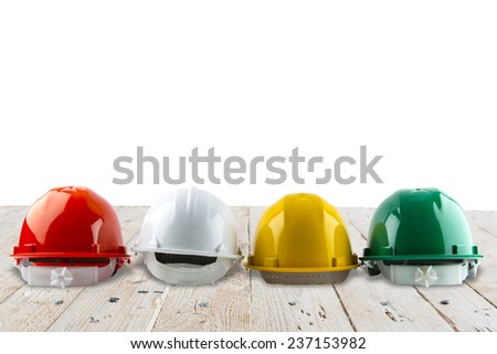 safety helmet and architect plant on wood table