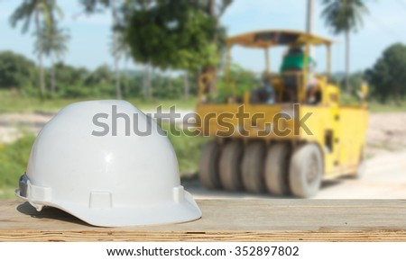 Safety helmet with over Construction site background